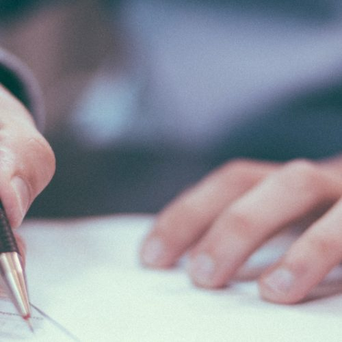 Seattle Divorce Services Lawyer reviewing a contract